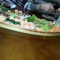 Photo taken at Yosugiru Sushi by Gabriela M. on 10/5/2013