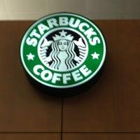 Photo taken at Starbucks by Ian Thomas on 12/21/2012