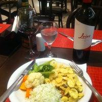 Photo taken at Bracia Parrilla Restaurante e Choperia by Renata F. on 2/22/2013