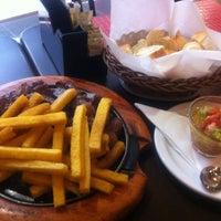 Photo taken at Bracia Parrilla Restaurante e Choperia by Renata F. on 1/13/2013