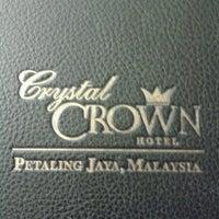 Photo taken at Crystal Crown Hotel by Jindah E. on 12/5/2012