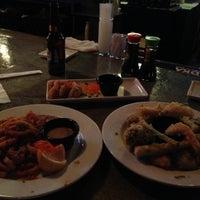 Photo taken at Koko Sushi Bar & Lounge by Patrick O. on 12/22/2012