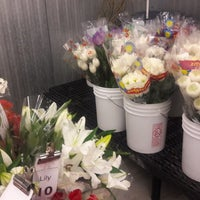Photo taken at Market Flowers by Brent M. on 6/17/2018