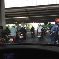 Photo taken at Wat Rama IX Intersection by Guy V. on 12/14/2012