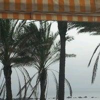 Photo taken at Playa Marina Beach by Arnold P. on 12/23/2012