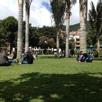 Photo taken at Parque de la 93 by Julian M. on 7/22/2013