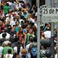 Photo taken at Rua 25 de Março by Cassiano C. on 7/19/2013