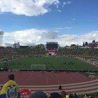 Photo taken at Estadio Olimpico Atahualpa by Ornella A. on 11/12/2015