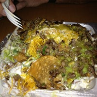 Photo taken at Don Tortaco Mexican Grill by maria s. on 12/29/2012