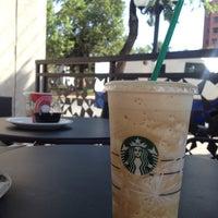 Photo taken at Starbucks by Daniela P. on 12/4/2014