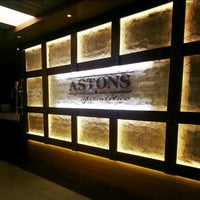 Photo taken at Astons Specialities by Clara C. on 3/3/2013