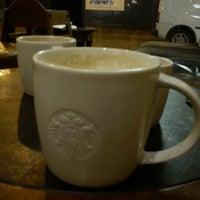 Photo taken at Starbucks by Emma C. on 11/13/2012