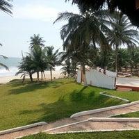 Photo taken at Till's Beach Hotel by Hisham K. on 12/1/2012