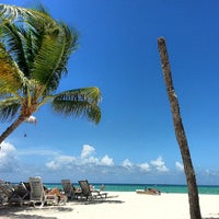 Photo taken at Playa Los Corales by Madelyn B. on 7/29/2013