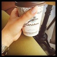 Photo taken at Caribou Coffee by Cansu A. on 5/22/2014