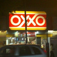 Photo taken at Oxxo Mirador by Sophie S. on 12/17/2012