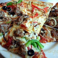 Photo taken at John's Pizza Cafe, Ltd. by Sam A. on 5/22/2013