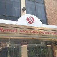 Photo taken at New York Marriott Downtown by Nikolas A. on 4/26/2013