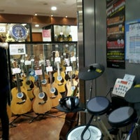 Photo taken at Yamano Music Ginza by Katsumi N. on 12/19/2012