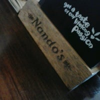 Photo taken at Nando's by Rie Y. on 11/10/2012