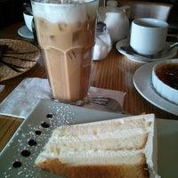 Photo taken at Pastiche Fine Desserts & Café by Yu-Teng H. on 4/27/2013
