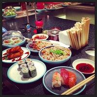 Photo taken at YO! Sushi by Evgeni A. on 1/21/2013