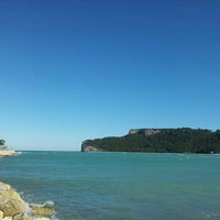 Photo taken at Moonlight Beach by Işıl A. on 2/22/2016