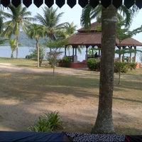 Photo taken at Teluk Dalam Beach Resort by Botak W. on 5/4/2014
