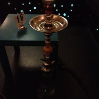 Photo taken at Qush Hookah Lounge by Tess O. on 12/15/2012