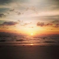 Photo taken at Sunset Beach by Courtney K. on 7/22/2013