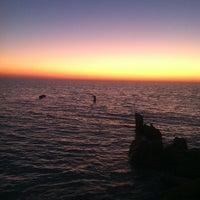 Photo taken at Sunset Beach by Courtney K. on 1/25/2013