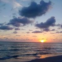 Photo taken at Sunset Beach by Courtney K. on 6/28/2013