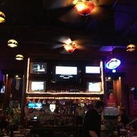 Photo taken at Tin Lizzy Tavern by Bryant G. on 3/24/2013