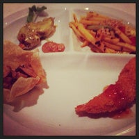 Photo taken at Mengrai Gourmet Thai by Austin D. on 3/23/2013