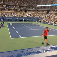 Photo taken at Arthur Ashe Stadium - USTA Billie Jean King National Tennis Center by Sebastian S. on 8/29/2013