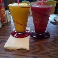 Photo taken at Red Robin Gourmet Burgers by Michelle G. on 11/21/2012