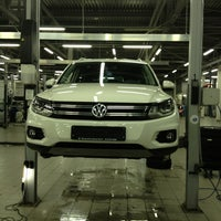 Photo taken at Volkswagen Центр Лахта by Roman A. on 12/19/2012