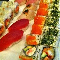 Photo taken at Sushi Sasa by Jenny F. on 3/30/2013