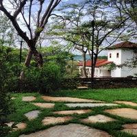 Photo taken at Pousada dos Pireneus Resort by Alessandro B. on 11/25/2012