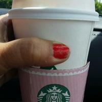 Photo taken at Starbucks by Juana E. on 4/16/2014