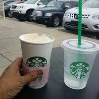 Photo taken at Starbucks by Juana E. on 4/13/2014
