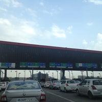 Photo taken at Gurgaon Toll Plaza by Manisha on 5/12/2013