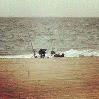 Photo taken at 76th Street Beach by Ryan H. on 10/7/2012