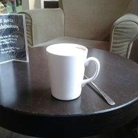 Photo taken at Balzac Coffee by Claudia E. on 3/21/2013
