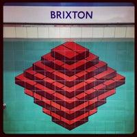 Photo taken at Brixton London Underground Station by Demsi on 9/7/2013