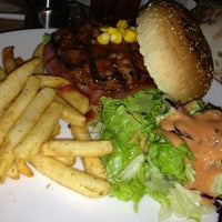 Photo taken at T Grill Burger & Steak Gourmet by melz m. on 7/5/2013