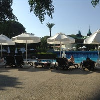 Photo taken at Gloria Verde Resort pool by Ersan Ö. on 7/8/2013