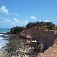 Photo taken at Praia de Cotovelo by Plinio D. on 12/31/2012
