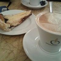 Photo taken at Café Botánico by Paola on 11/16/2012