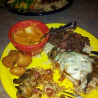Photo taken at Red Beans Bayou Grill by Lucy G. on 9/29/2012